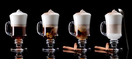 latte macchiato: cup of coffee latte macchiato on a black background Stock Photo