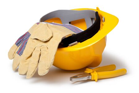 Hard Hat, Leather Gloves and pliers isolated on white photo