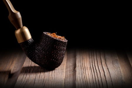 Wooden Pipe and Tobacco photo