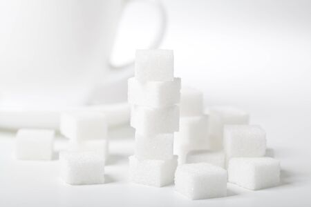 sucrose: Sugar cube isolated on a white background