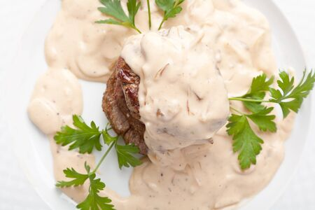 Roasted meat under white sauce Stock Photo - 13547679