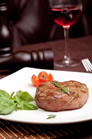 Grilled steak on a white plate Stock Photo - 13717207