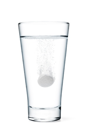 Fizzy tablet in glass of water isolated on white Stock Photo - 14757038