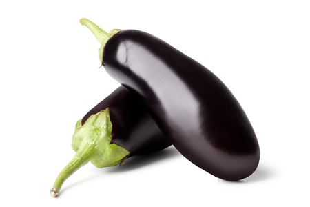 Fresh vegetable eggplant on a white