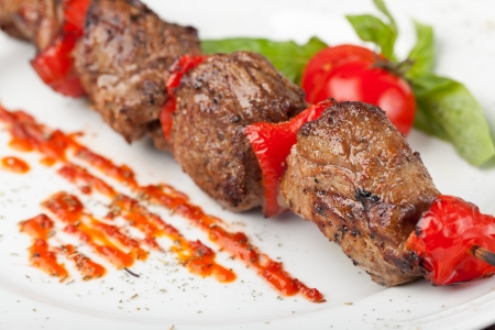 Grilled meat on a white plate photo
