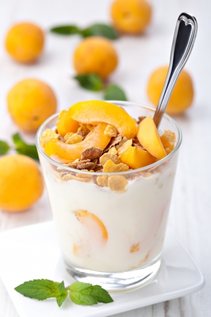 cornflakes: yogurt with muesli and apricot in small glass