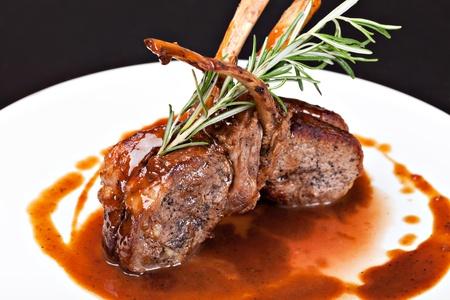 lamb chop: Roasted Lamb Chops on Tomato Sauce Stock Photo