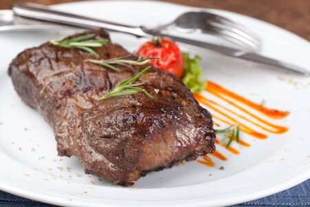 charbroiled: Grilled sirloin steak on a white plate Stock Photo