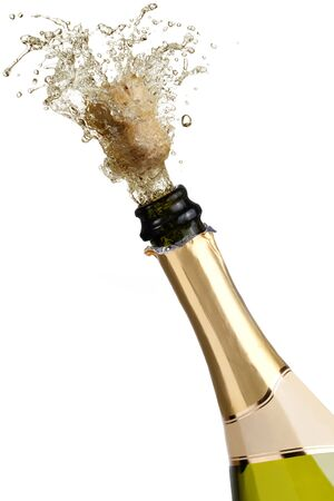 popping cork: bottle of champagne popping its cork and splashing