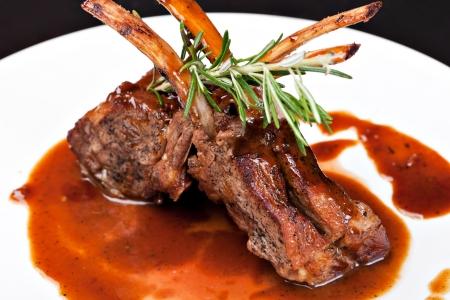 mutton: Roasted Lamb Chops on Tomato Sauce Stock Photo