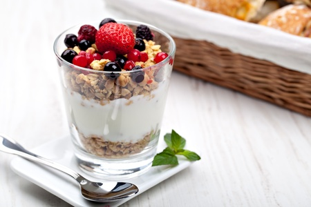 cereal bowl: yogurt with muesli and berries in small glass