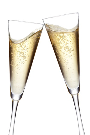 Champagne flutes toasting  Isolated on white background Stock Photo