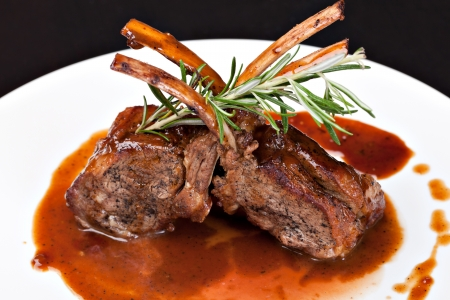roast lamb: Roasted Lamb Chops on Tomato Sauce Stock Photo