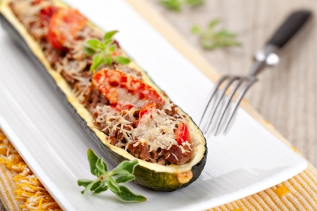 Zucchini halves stuffed with minced meat and vegetable photo