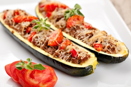 prepared food: Zucchini halves stuffed with minced meat and vegetable