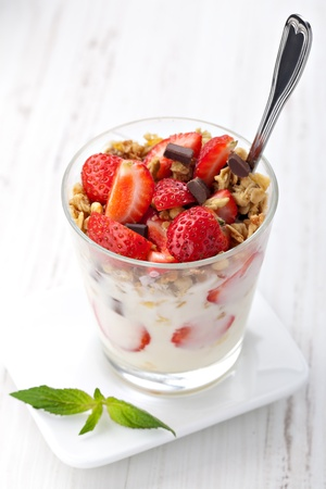 yoghurt with granola and strawberries in glass