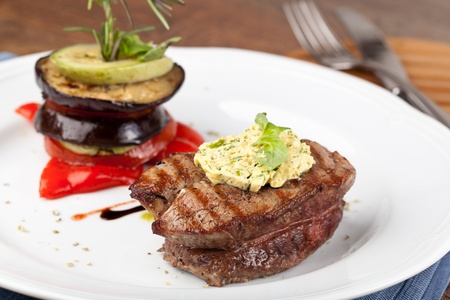 Closeup of a gourmet dinner plate with a steak, vegetables and potatoes Stock Photo - 16673624