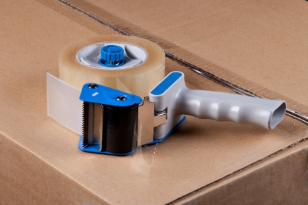 dispense: Packaging Tape Gun Dispenser Isolated Over White Stock Photo