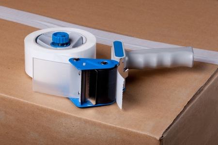 adhere: Packaging Tape Gun Dispenser Isolated Over White Stock Photo