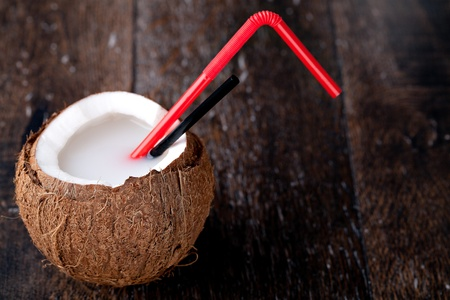 coconut drink: Coconut cocktail with red straw  Stock Photo