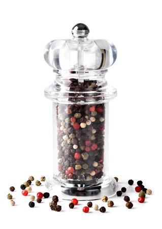 pepper grinder: Colored Peppers Mix and pepper grinder on white background