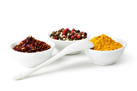 Spices Curry, Peppers Mix and paprika in ceramic bowl on a white background photo