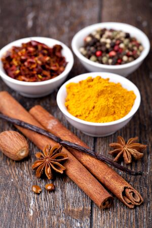 anice: Spice collection on a wooden table Stock Photo