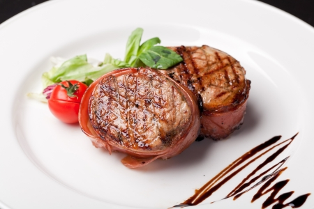 Grilled bbq steak wrapped in prosciutto