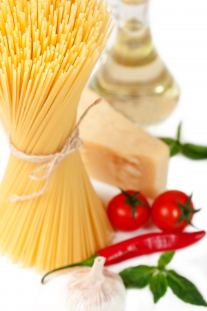 Spaghetti, tomatoes, and cheese on a white background Stock Photo - 18252723