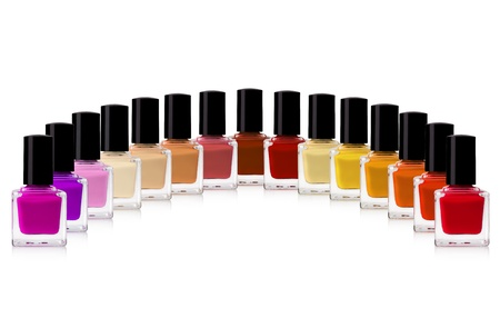 abreast: red nail polish bottle on white background Stock Photo