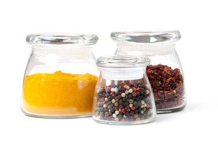 Spices Curry, Peppers Mix and paprika in glass containers on a white background photo