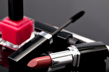 Various Cosmetics on grey background photo