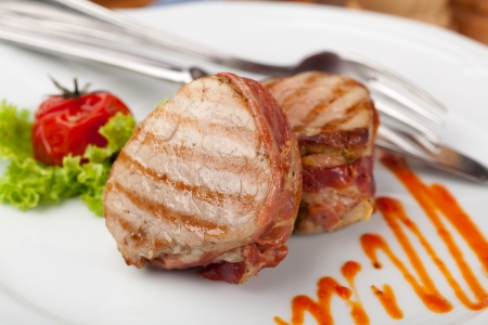 charbroiled: Grilled bbq steak wrapped in prosciutto Stock Photo