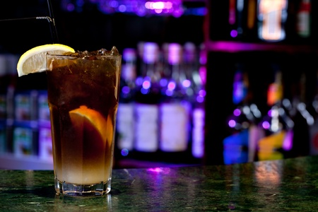 long life: Long Island Iced Tea on the background of the bar