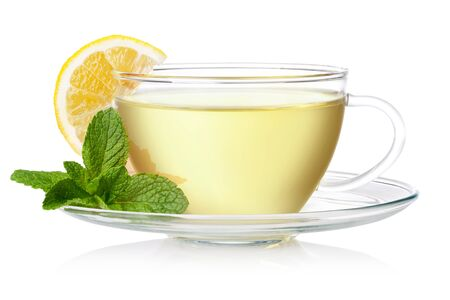 green tea cup: Cup of green tea with mint and lemon on a white background