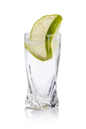 vodka bottle: cold vodka shots on a white background Stock Photo