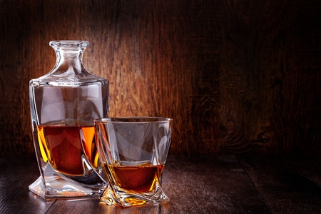 scotch whisky: Glass of scotch whiskey on a wooden table