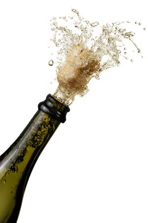 corcho: botella de champ�n haciendo estallar su corcho y salpicaduras