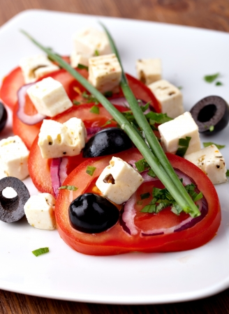 Tomato salad with feta and olives Stock Photo