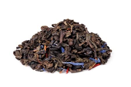gunpowder tea: aromatic Gunpowder tea with fruits and petals isolated on white Stock Photo