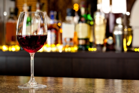 Wine glass on the background of the bar Stock Photo