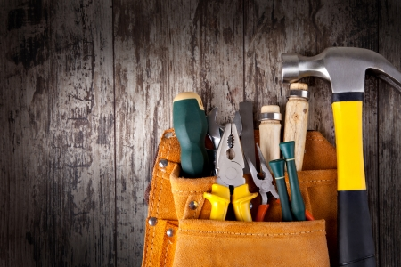 set of tools in tool box on a wooden background photo