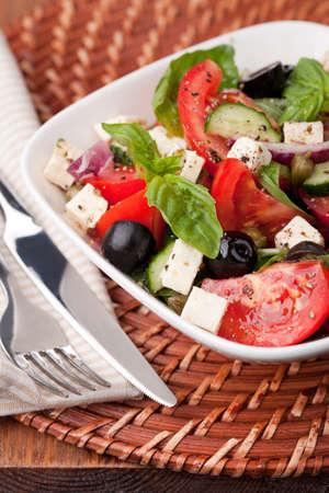 Greek vegetable salad with feta cheese photo