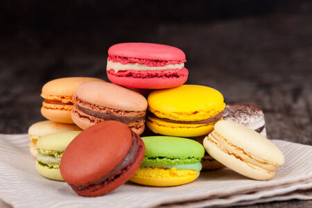 Macaroons on a wooden table photo