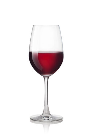 Glass of red wine isolated on a white background Фото со стока