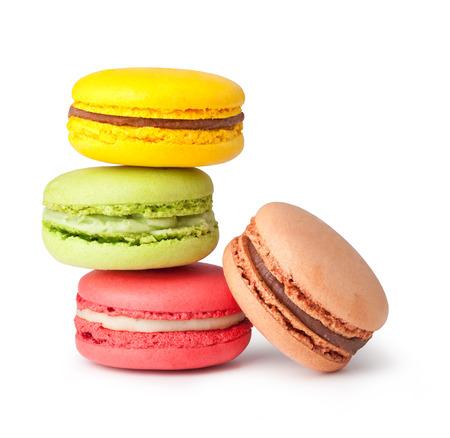 Smakelijke kleurrijke bitterkoekjes op een witte achtergrond Stockfoto