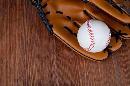 mitt: Baseball and mitt on rustic wooden background