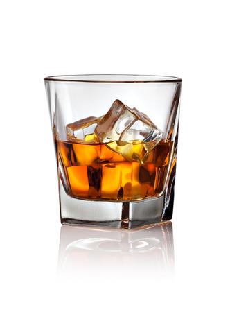 Glass of scotch whiskey and ice on a white background Imagens