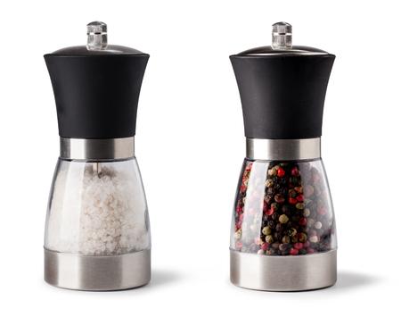 Salt and pepper grinder on white background