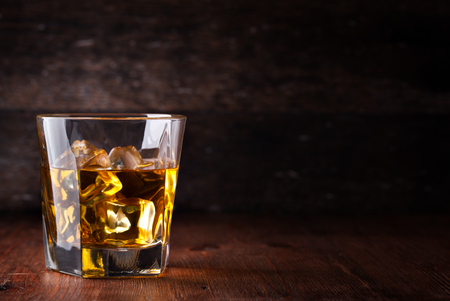 shot: Glass of scotch whiskey and ice Stock Photo